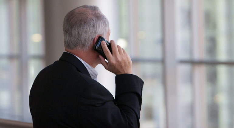 A businessman is seen talking on a burner phone. Some businesses decide to become whistleblowers and report a cartel they are a part of.